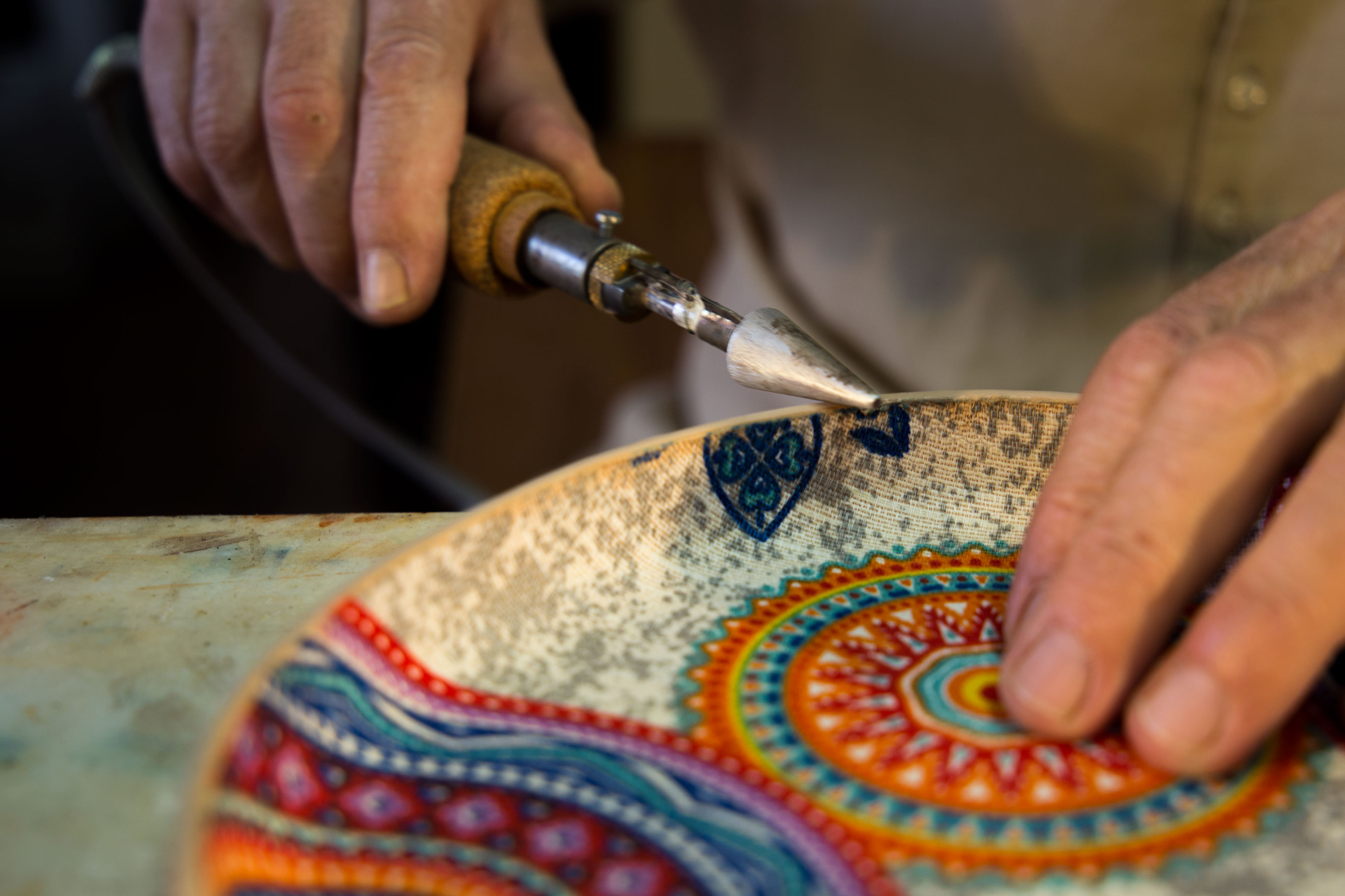 leather artist creating a dish