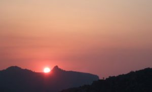 sunset over the mountains at retreat venue Spain
