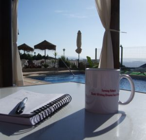 notebook and pen at retreat venue Spain