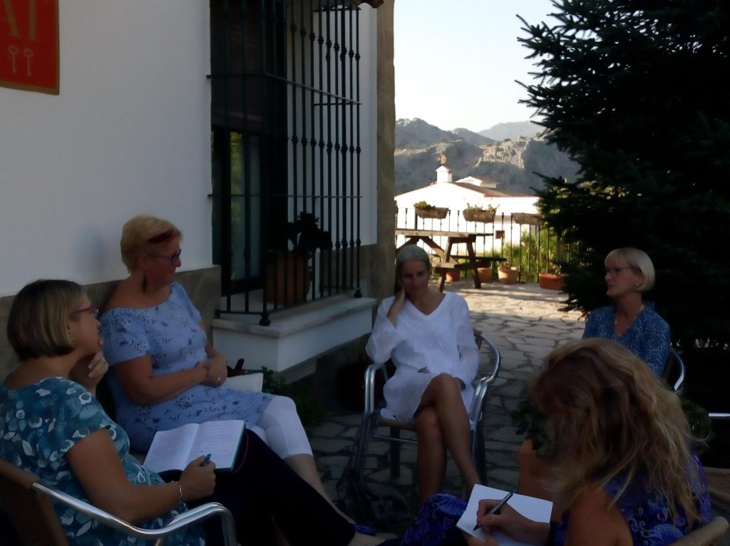 writers sitting outdoors in a group activity on a writing retreat in Spain