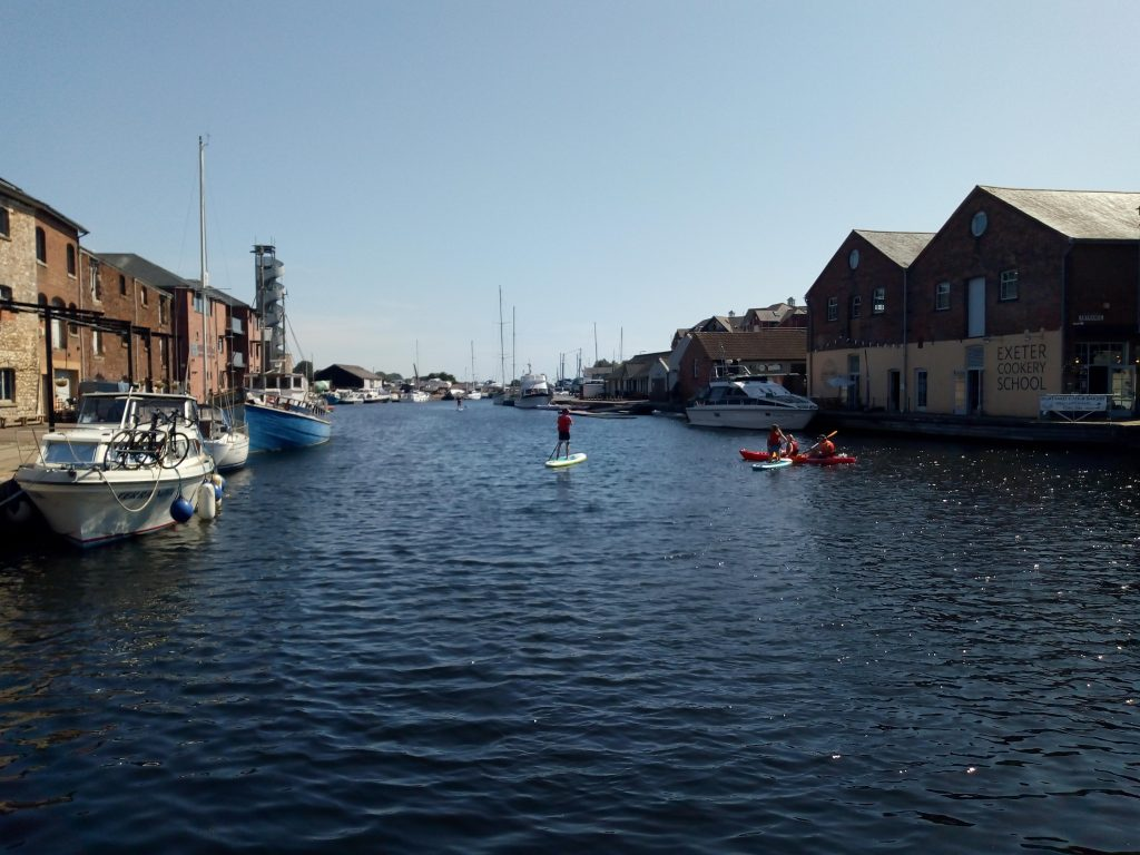 Earn money and travel so that you can take part in activities like canoeing on Exeter canal
